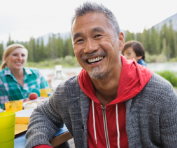 Man smiling at picnic table